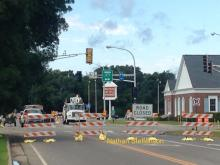 Intersection with road closed sign and stoplight off